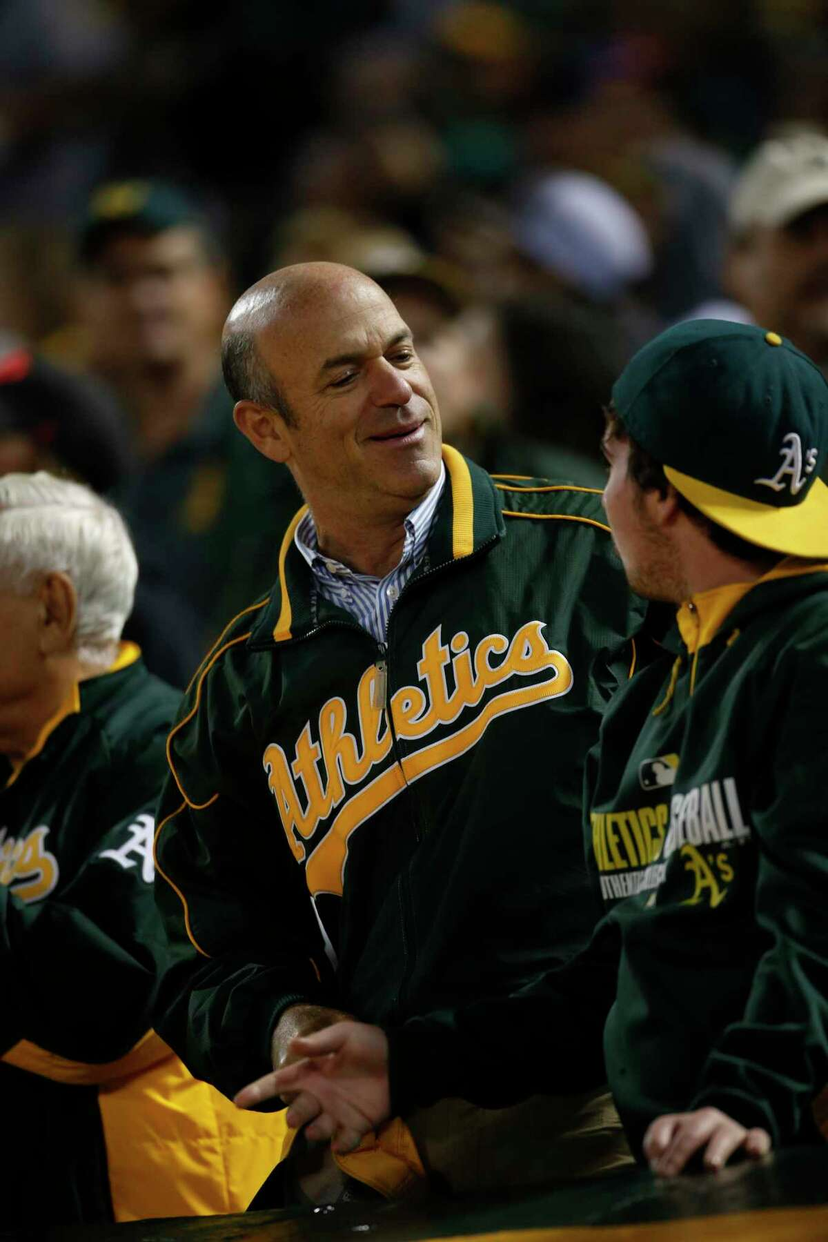 OAKLAND, CA - JULY 19: Owner John Fisher of the Oakland Athletics stands in the stands during the game against the Houston Astros at the Oakland Coliseum on July 19, 2016 in Oakland, California. The Athletics defeated the Astros 4-3. (Photo by Michael Zagaris/Oakland Athletics/Getty Images)