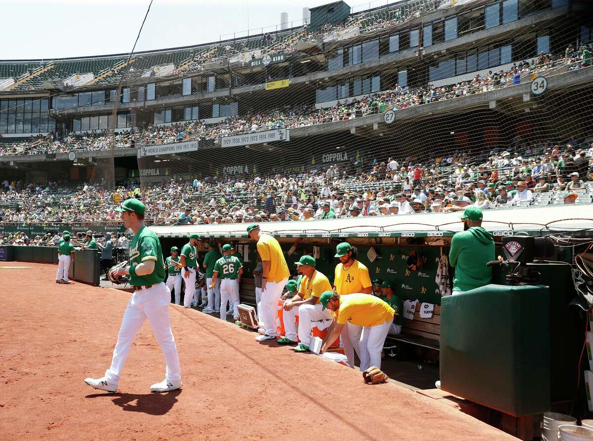 Oakland Athletics' Mark Canha heads to left field before start of A's game against Cleveland Indians at Oakland Coliseum in Oakland, Calif., on Sunday, July 18, 2021.