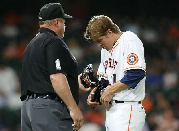 Houston Astros starting pitcher Zack Greinke (21) has his hat and glove checked by umpire Bruce Dreckman (1) after pitching in the fourth inning against the Cleveland Indians at Minute Maid Park on Monday, July 19, 2021. Houston Astros host Cleveland Indians for a three-game series. Photo: Elizabeth Conley/Staff Photographer / © 2021 Houston Chronicle