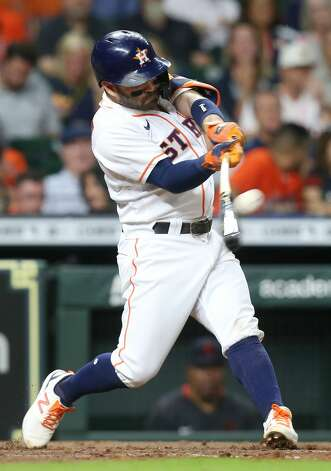 Houston Astros second baseman Jose Altuve (27) connects for a fly out in the fourth inning against Cleveland Indians at Minute Maid Park on Monday, July 19, 2021. Houston Astros host Cleveland Indians for a three-game series. Photo: Elizabeth Conley/Staff Photographer / © 2021 Houston Chronicle