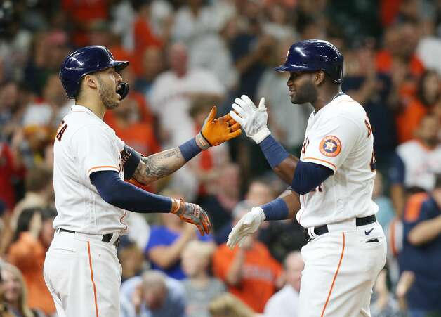 Houston Astros designated hitter Yordan Alvarez (44) and teammate Carlos Correa (1) celebrate Alvarez's two-run home run in the fifth inning against Cleveland Indians at Minute Maid Park on Monday, July 19, 2021. Houston Astros host Cleveland Indians for a three-game series. Photo: Elizabeth Conley/Staff Photographer / © 2021 Houston Chronicle