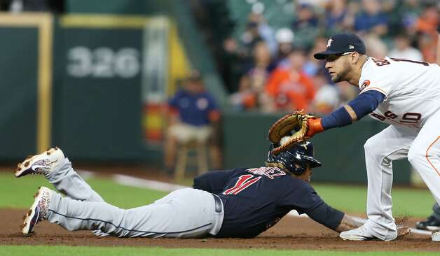 Cleveland Indians third baseman Jose Ramirez (11) slides safely into first under Houston Astros first baseman Yuli Gurriel (10) in the first inning at Minute Maid Park on Monday, July 19, 2021. Houston Astros host Cleveland Indians for a three-game series. Photo: Elizabeth Conley/Staff Photographer / © 2021 Houston Chronicle