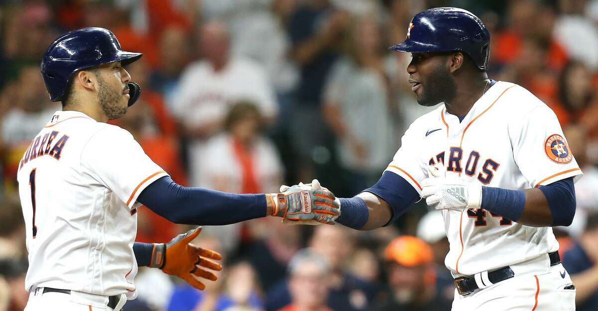 Houston Astros designated hitter Yordan Alvarez (44) and teammate Carlos Correa (1) celebrate Alvarez's two-run home run in the fifth inning against Cleveland Indians at Minute Maid Park on Monday, July 19, 2021. Houston Astros host Cleveland Indians for a three-game series.