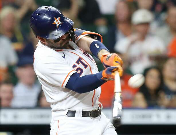 Houston Astros second baseman Jose Altuve (27) connects by flies out in the sixth inning against the Cleveland Indians at Minute Maid Park on Monday, July 19, 2021. Houston Astros host Cleveland Indians for a three-game series. Photo: Elizabeth Conley/Staff Photographer / © 2021 Houston Chronicle