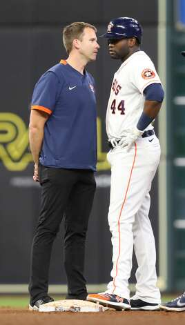 Houston Astros trainer Jeremiah Randall checks on Houston Astros designated hitter Yordan Alvarez (44) after he hit a double in the seventh inning against the Cleveland Indians at Minute Maid Park on Monday, July 19, 2021. Houston Astros host Cleveland Indians for a three-game series. Photo: Elizabeth Conley/Staff Photographer / © 2021 Houston Chronicle