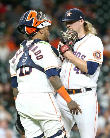 Houston Astros catcher Martin Maldonado (15) talks to Houston Astros relief pitcher Ryne Stanek (45) in the eighth inning against Cleveland Indians at Minute Maid Park on Monday, July 19, 2021. Houston Astros host Cleveland Indians for a three-game series. Photo: Elizabeth Conley/Staff Photographer / © 2021 Houston Chronicle