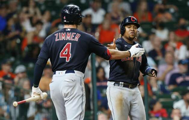 Cleveland Indians center fielder Bradley Zimmer (4) congratulates Cleveland Indians third baseman Jose Ramirez (11) after he scored off of a single by Cleveland Indians left fielder Harold Ramirez (40) in the eight inning against the Houston Astros at Minute Maid Park on Monday, July 19, 2021. Houston Astros host Cleveland Indians for a three-game series. Photo: Elizabeth Conley/Staff Photographer / © 2021 Houston Chronicle
