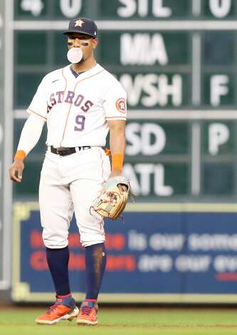 Houston Astros second baseman Robel Garcia (9) blows a bubble between Cleveland Indians batters in the eighth inning at Minute Maid Park on Monday, July 19, 2021. Houston Astros host Cleveland Indians for a three-game series. Photo: Elizabeth Conley/Staff Photographer / © 2021 Houston Chronicle