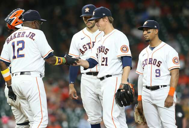 Houston Astros manager Dusty Baker Jr. (12) takes the game ball from Houston Astros starting pitcher Zack Greinke (21) in the sixth inning against the Cleveland Indians at Minute Maid Park on Monday, July 19, 2021. Houston Astros host Cleveland Indians for a three-game series. Photo: Elizabeth Conley/Staff Photographer / © 2021 Houston Chronicle