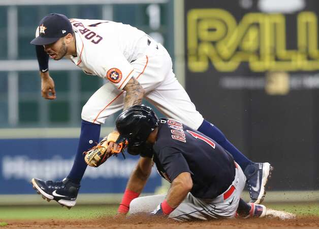 Houston Astros shortstop Carlos Correa (1) gets Cleveland Indians shortstop Amed Rosario (1) out at second in the sixth inning at Minute Maid Park on Monday, July 19, 2021. Houston Astros host Cleveland Indians for a three-game series. Photo: Elizabeth Conley/Staff Photographer / © 2021 Houston Chronicle
