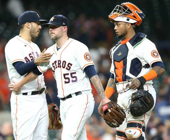 Houston Astros relief pitcher Ryan Pressly (55) is congratulated by teammate Carlos Correa (1) after getting the save for the Astros against Cleveland Indians at Minute Maid Park on Monday, July 19, 2021. Houston Astros won the game 4-3. Photo: Elizabeth Conley/Staff Photographer / © 2021 Houston Chronicle