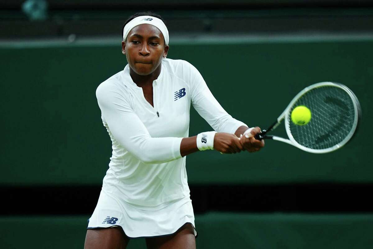 In this photo from July 6, 2021, Coco Gauff of The United States, playing partner of Caty McNally of The United States plays a backhand in their Ladies' Doubles Third Round match against Veronika Kudermetova and Elena Vesnina of Russia during Day Eight of The Championships - Wimbledon 2021 at All England Lawn Tennis and Croquet Club in London, England. Gauff will not be playing in the Olympics after testing positive for COVID-19. (Mike Hewitt/Getty Images/TNS)