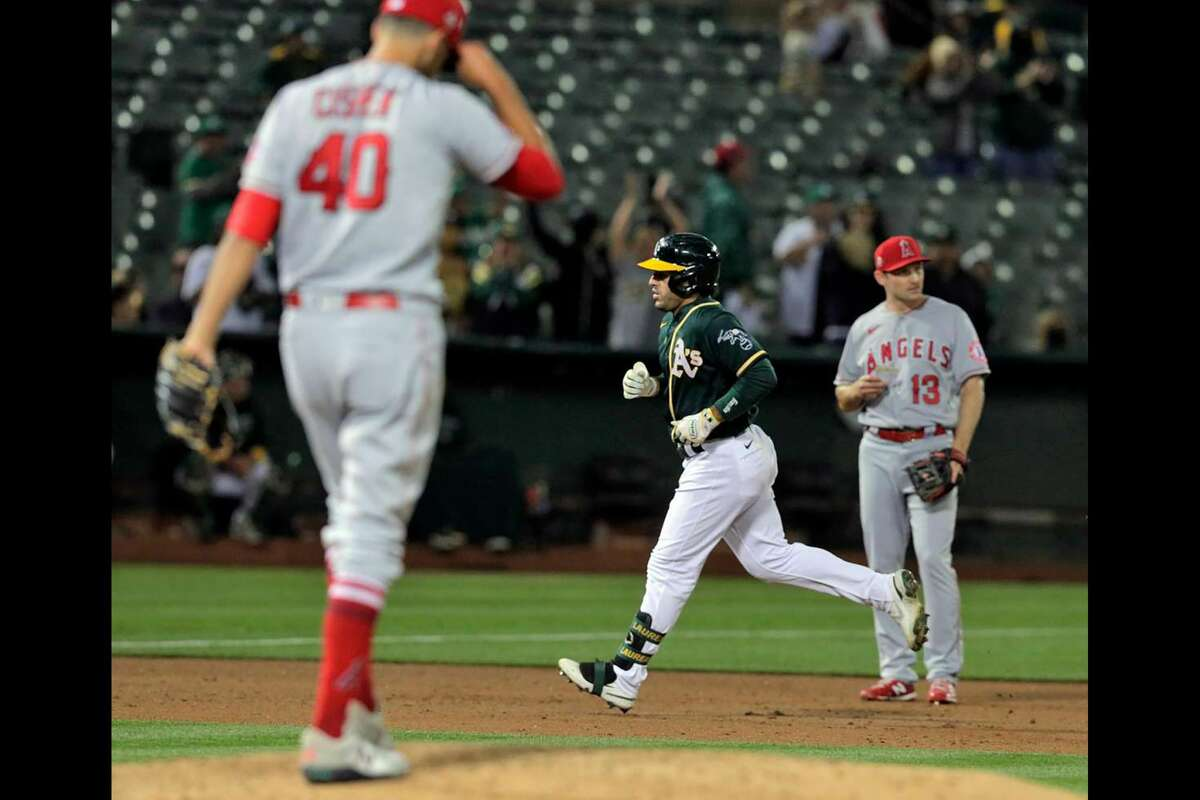 Ramon Laureano (22) rounds the bases after hitting a three run homerun in the seventh inning off reliever Steve Cishek (40) as the Oakland Athletics played the Los Angeles Angels at the Coliseum in Oakland, Calif., on Monday, July 19, 2021.