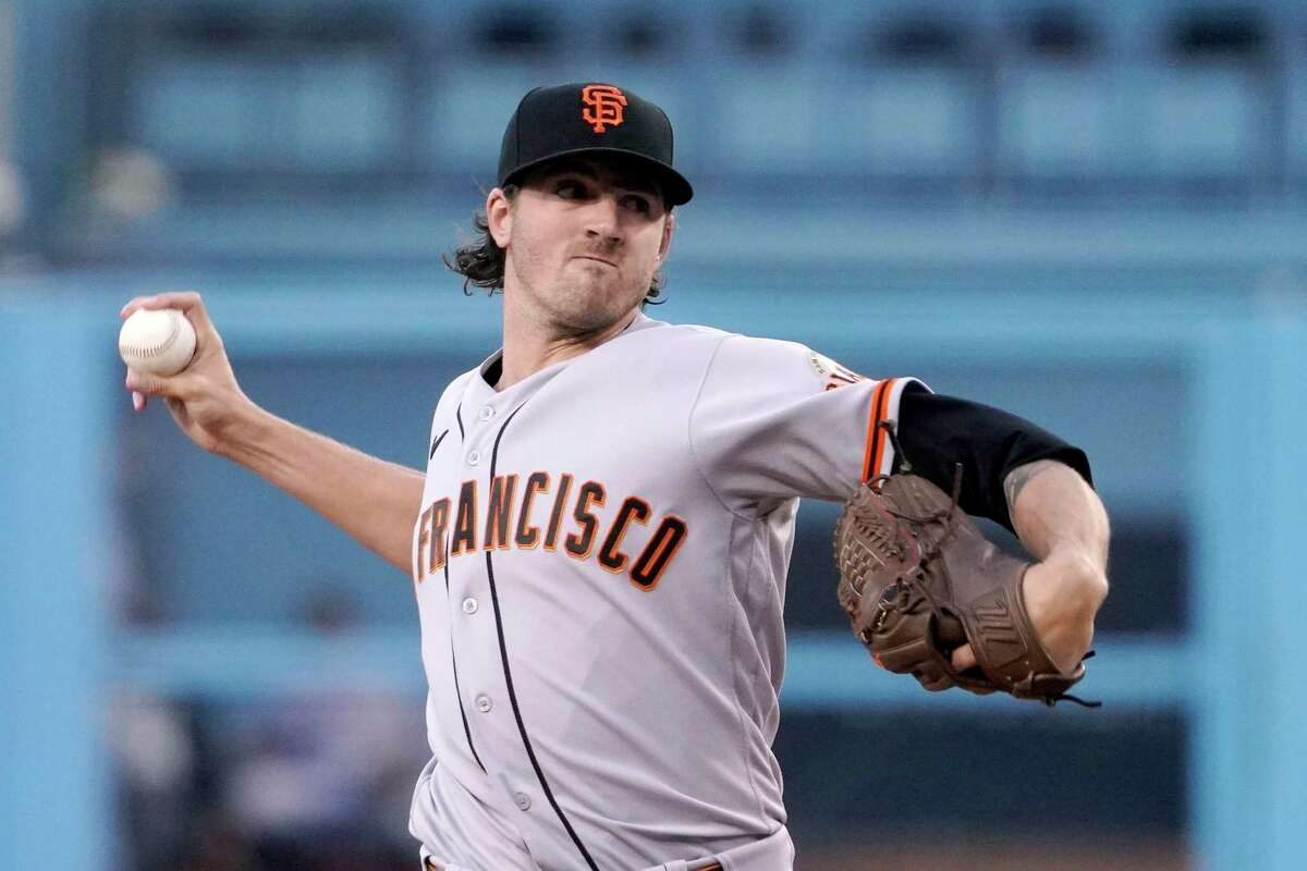 San Francisco Giants starting pitcher Kevin Gausman throws to the plate during the first inning of a baseball game against the Los Angeles Dodgers Monday, July 19, 2021, in Los Angeles. (AP Photo/Mark J. Terrill)