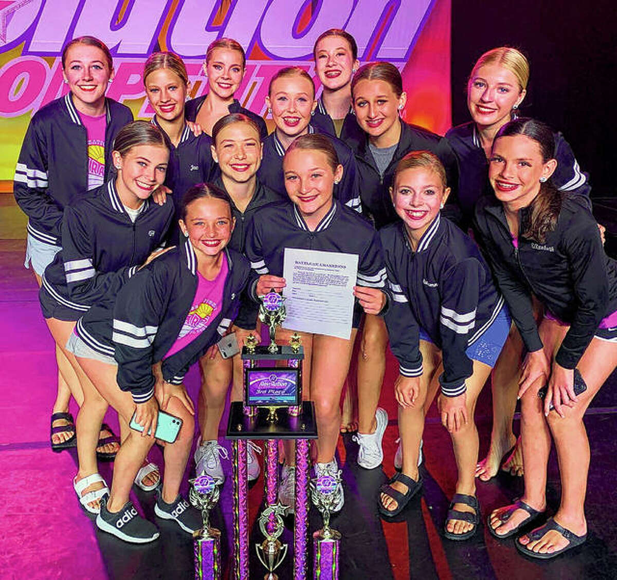 """Students of Sara's Studio of Dance recently attended Revolution Nationals, competing against dancers from some of the top studios in the United States. Sara's teams won 14 Revolutionary Awards, meaning the teams or soloists scored at least 295 points out of a possible 300. They also won 22 platinum awards, 10 Elite Gold awards, one first-place award, four second-place awards and three third-place awards. They had five """"Battle finalists"""" and dancer Jaycee Bates earned a first-runner-up title."""