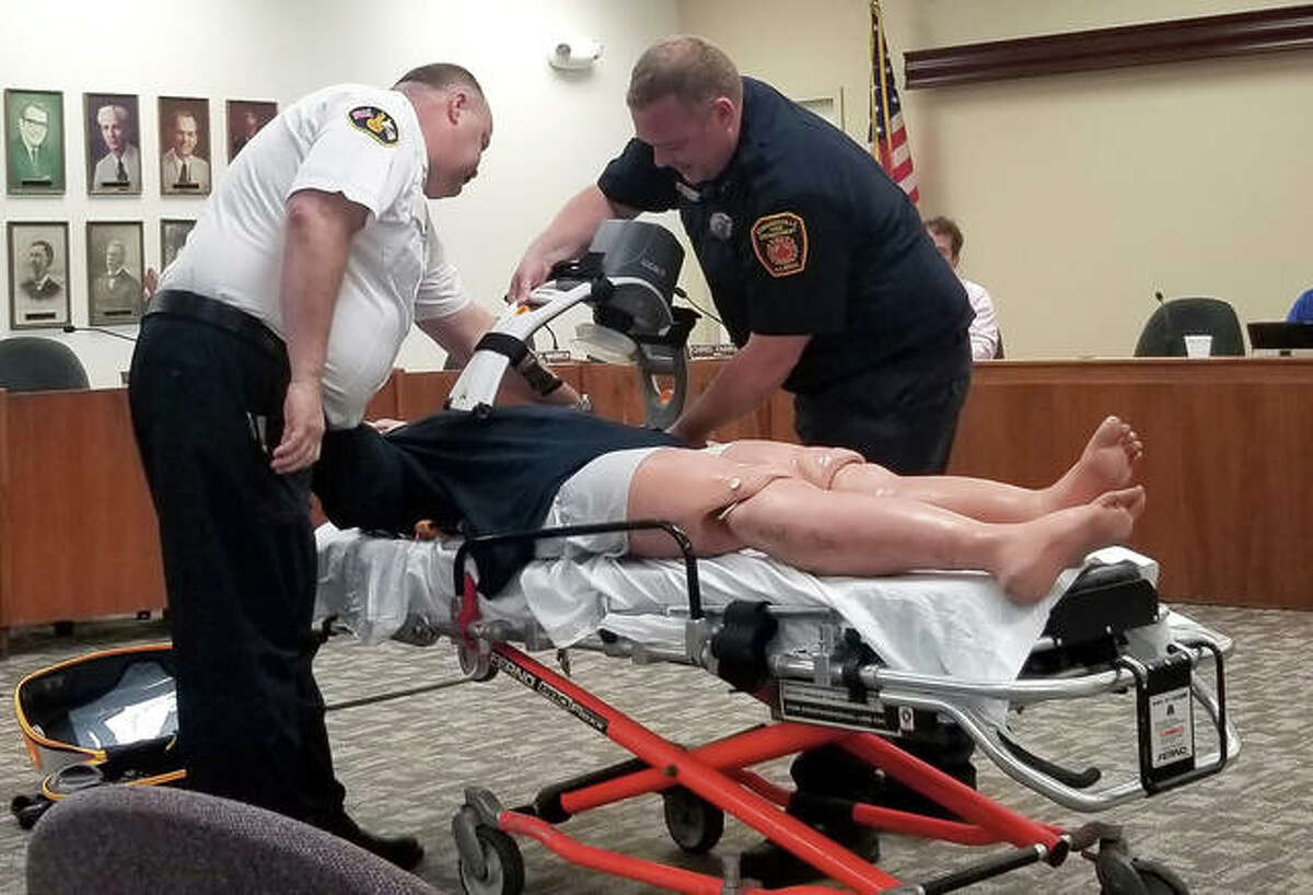 Edwardsville Fire Chief James Whiteford and city paramedic Chad Lankford demonstrated the Lucas CPR machine during the Public Safety Committee meeting last year.