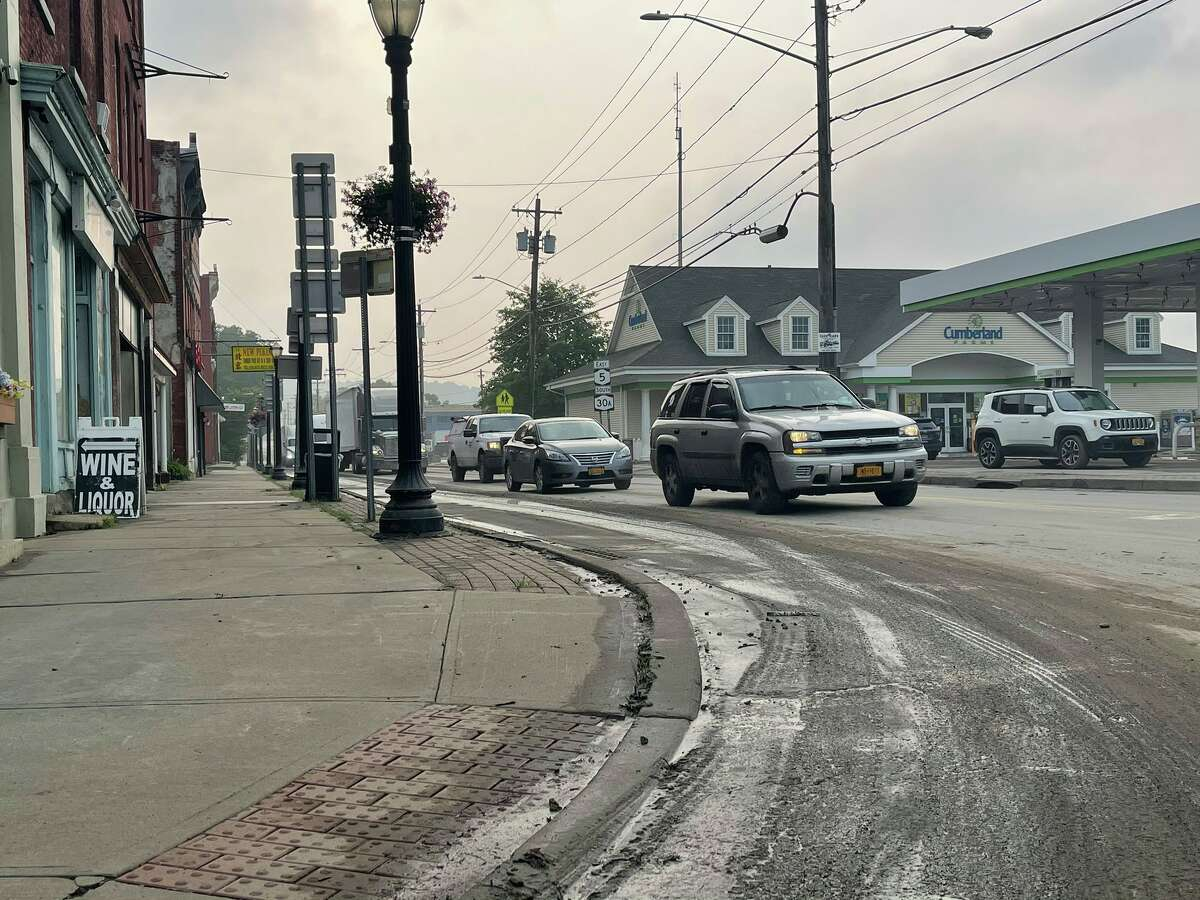 Fonda was flooded when torrential rains hit Monday night. It left streets unpassable but by Tuesday morning the flooding had subsided, leaving a thick layer of mud behind.