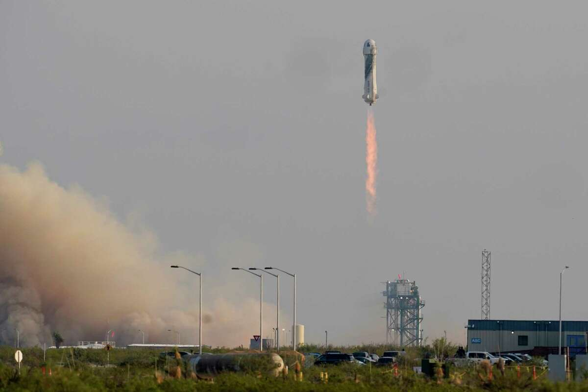 Blue Origin's New Shepard rocket launches carrying passengers Jeff Bezos, founder of Amazon and space tourism company Blue Origin, brother Mark Bezos, Oliver Daemen and Wally Funk, from its spaceport near Van Horn, Texas, Tuesday, July 20, 2021.