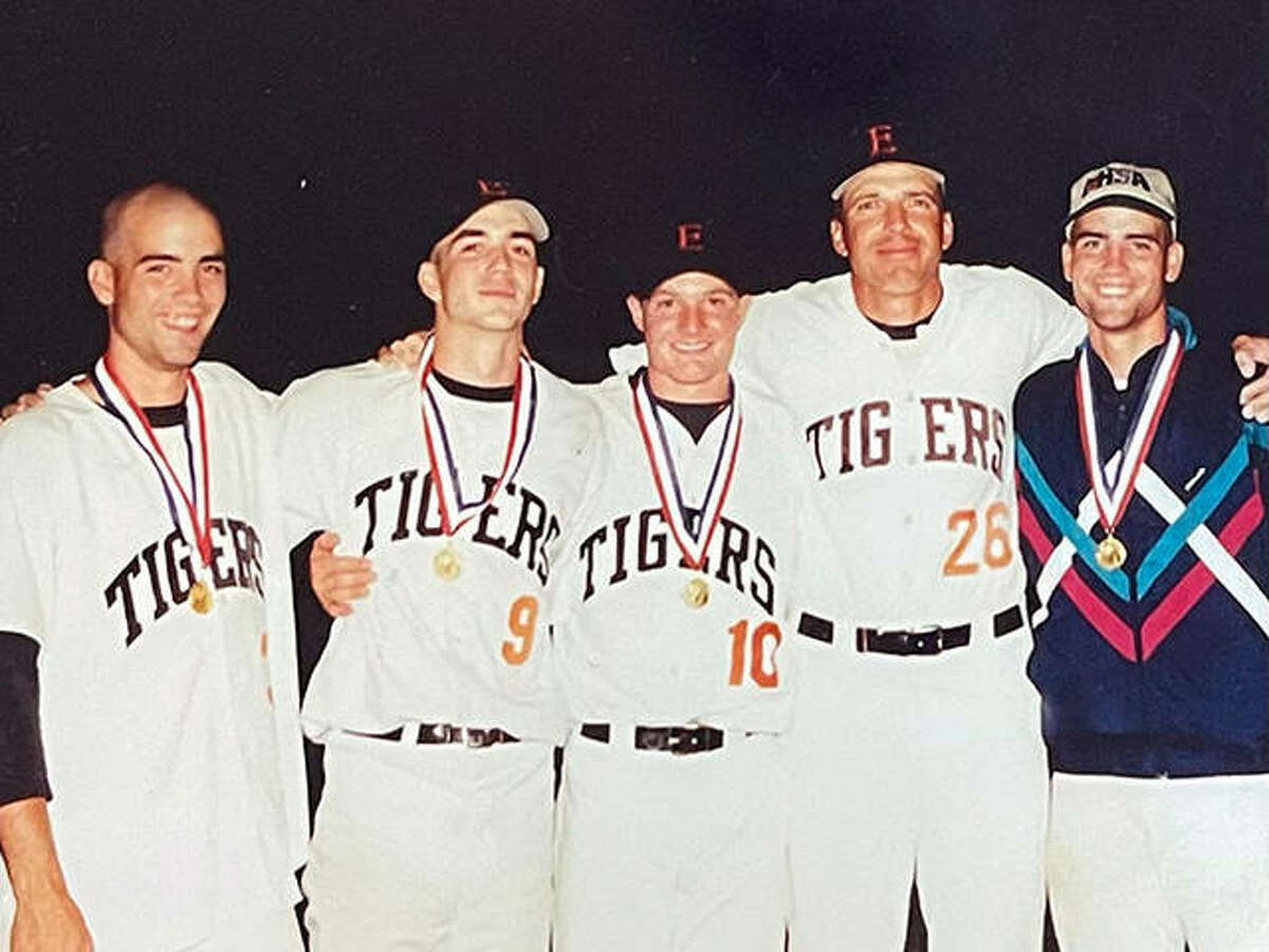 Edwardsville pitching coach Mike Waldo, second from right, with the EHS pitchers, left to right, Ben Hutton, Justin Hampson, Brad Grotefendt and James Hutton, after the Tigers won the Class AA state championship in 1998.
