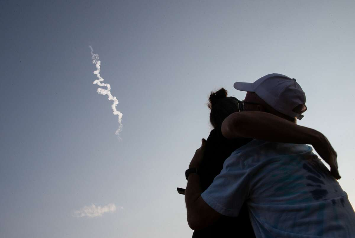 People cheer as they watch the launch of Blue Origin's NS-16 on Tuesday, July 20, 2021, near Launch Site One near Van Horn.