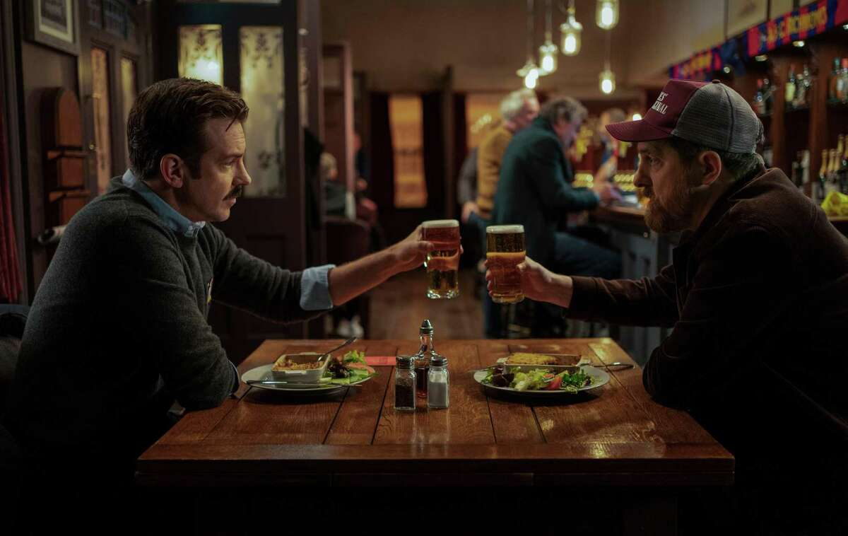 """Jason Sudeikis and Brendan Hunt in """"Ted Lasso"""" season two, premiering Friday, July 23, on Apple TV+."""