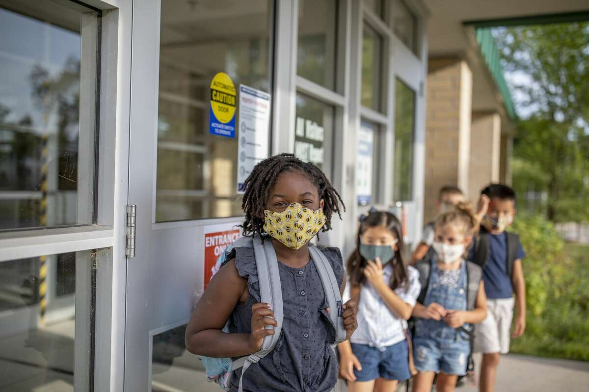 FILE - Group of kids return to school during the pandemic.