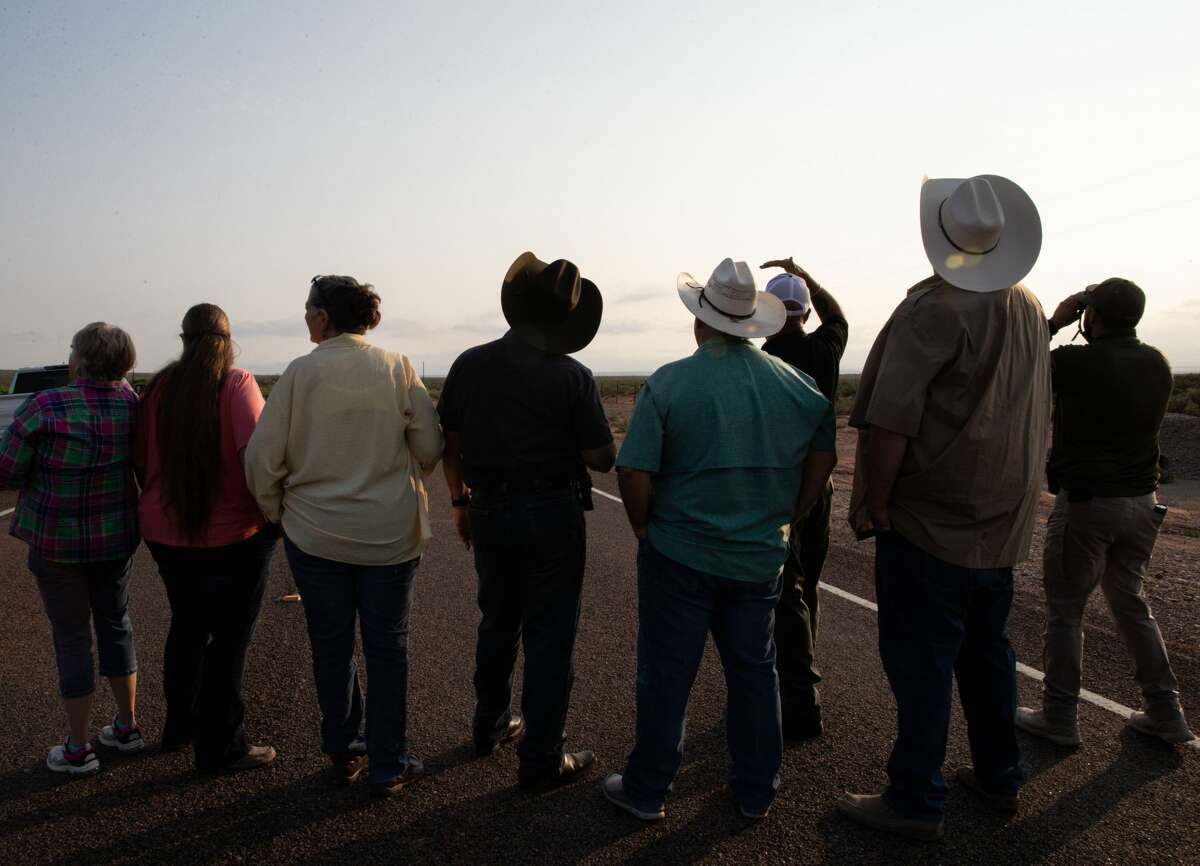 People watch the launch of Blue Origin's NS-16 on Tuesday, July 20, 2021, near Launch Site One near Van Horn.