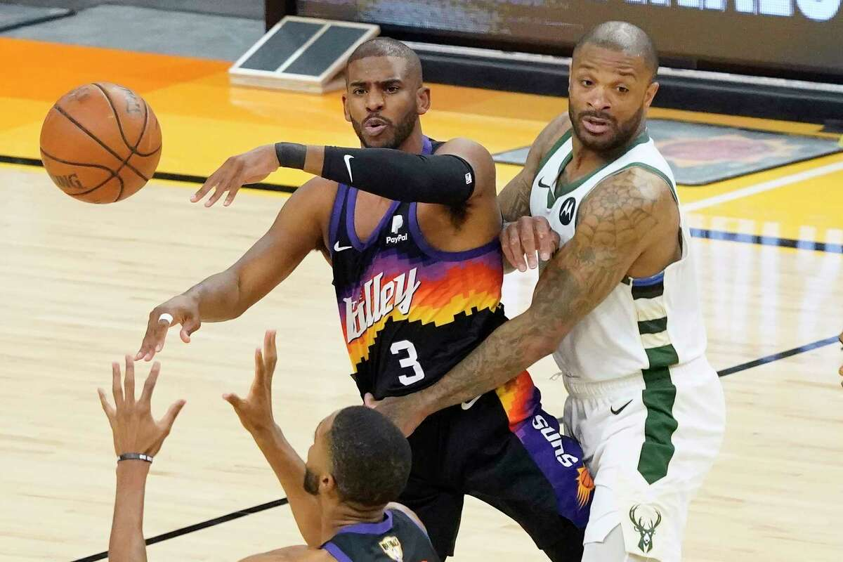 Chris Paul and P.J. Tucker - former teammates in Houston - are both looking for their first NBA title this week.