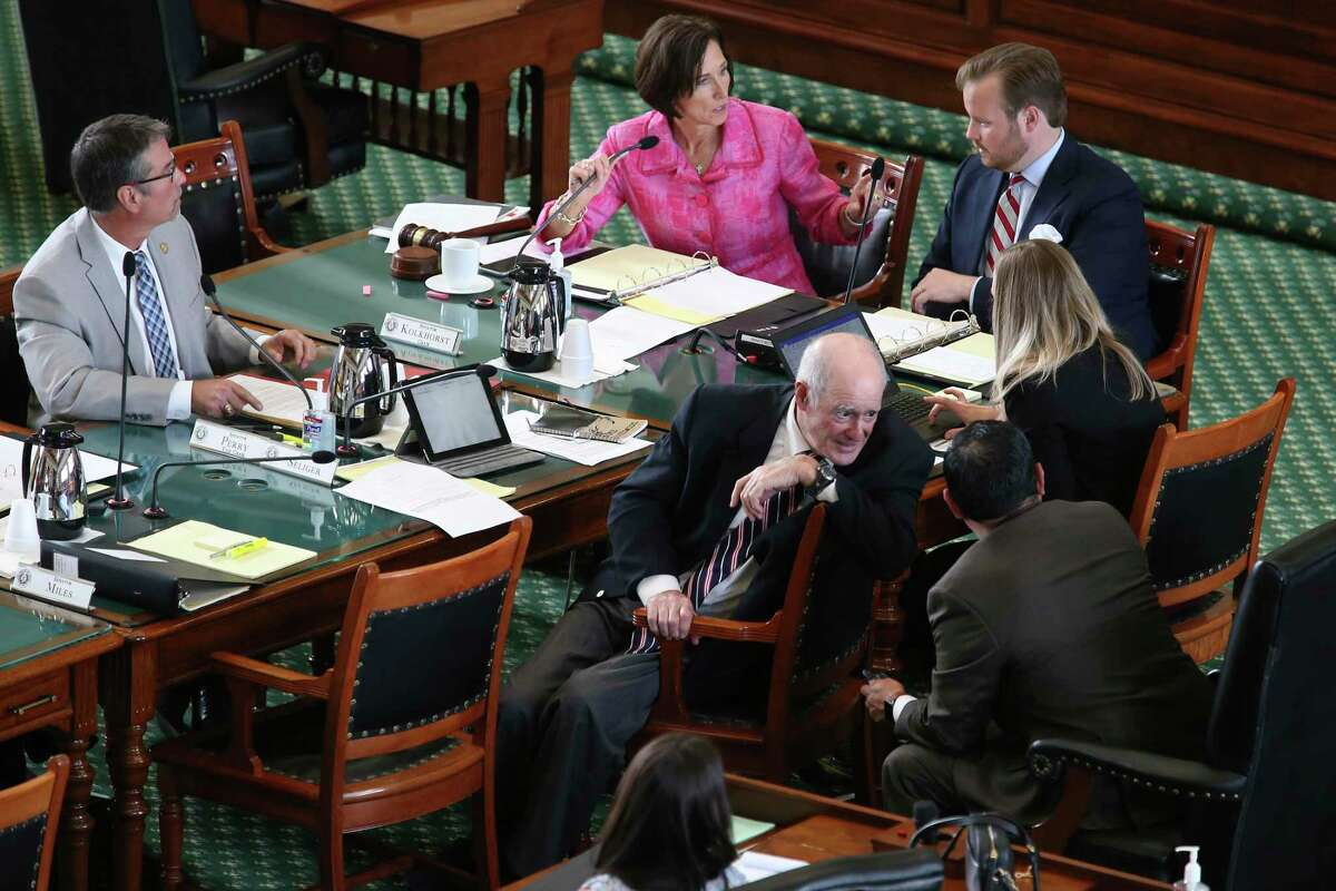 Texas Sen. Lois Kolkhorst, R-Brenham, in pink, gavels in the Senate Committee on Health and Human Services on the floor of the Senate Chambers, Monday, July 12, 2021. Only Republicans were present for the hearing on SB2, which would ban transgender students from competing on sports teams aligning with their gender identity.