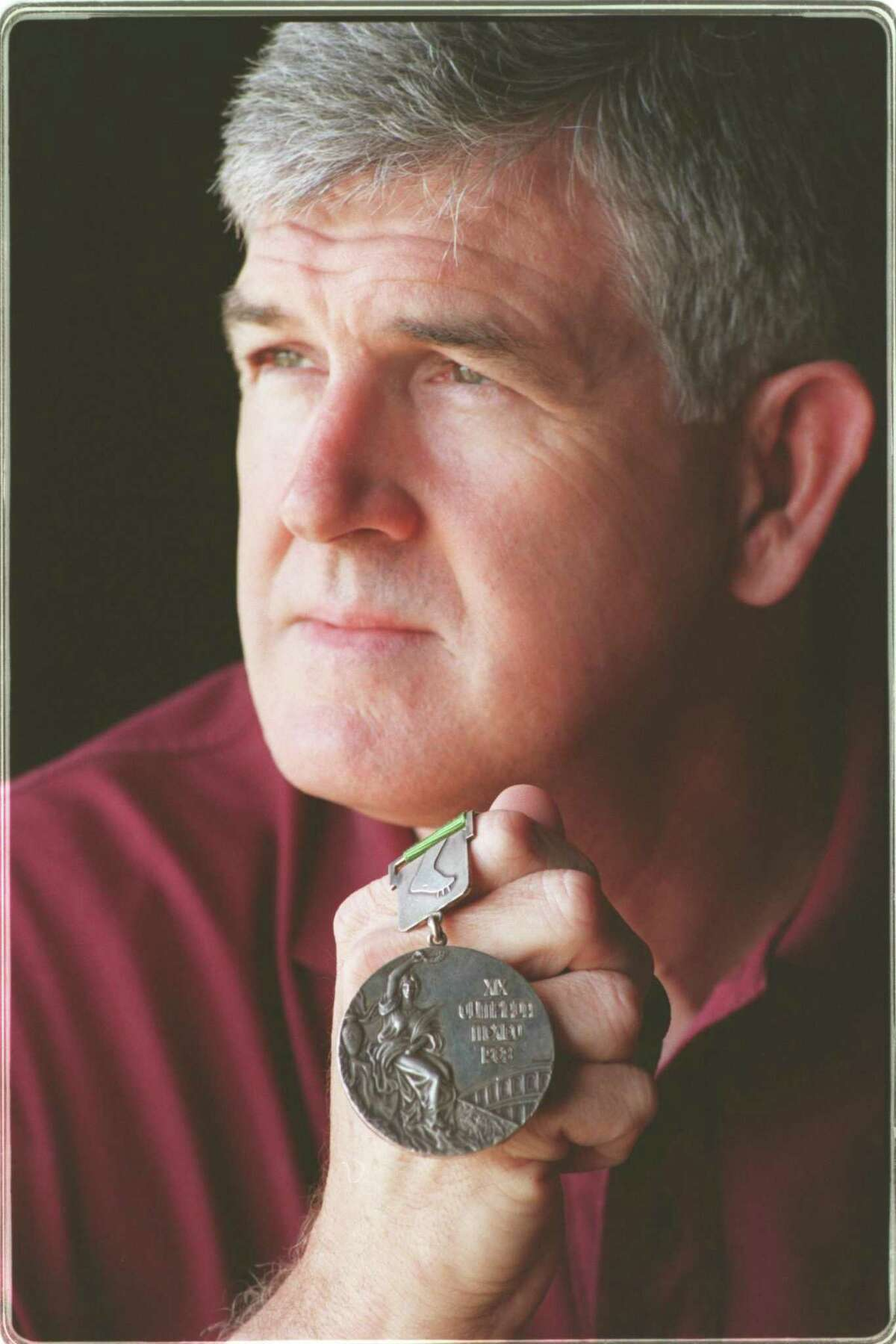 Former Texas A&M shot putter Randy Matson with his gold medal fro Mexico City. He also won silver in Tokyo.