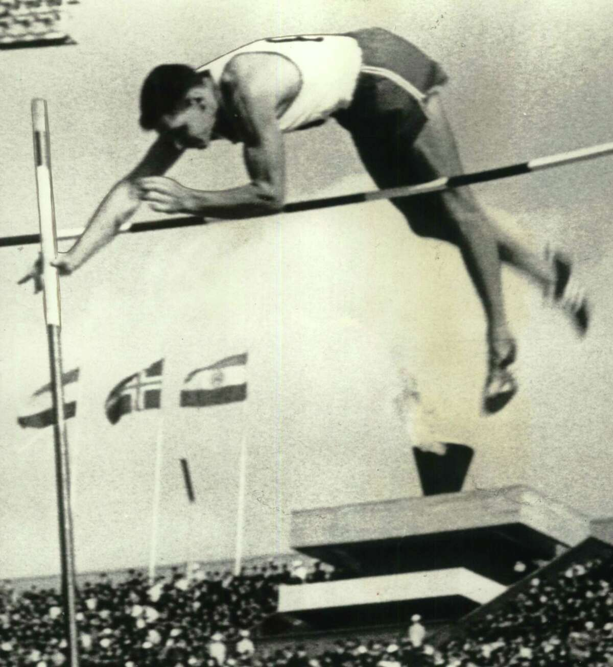 Pole vaulter Fred Hansen clears the bar in the early going during the 1964 Olympic Games, which event he won dramatically.