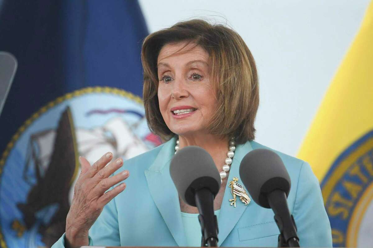 Speaker of the House Nancy Pelosi speaks at a christening ceremony for the the USNS John Lewis in San Diego. A member of Pelosi's staff tested positive for the coronavirus after meeting with a group of Texas Democrats.