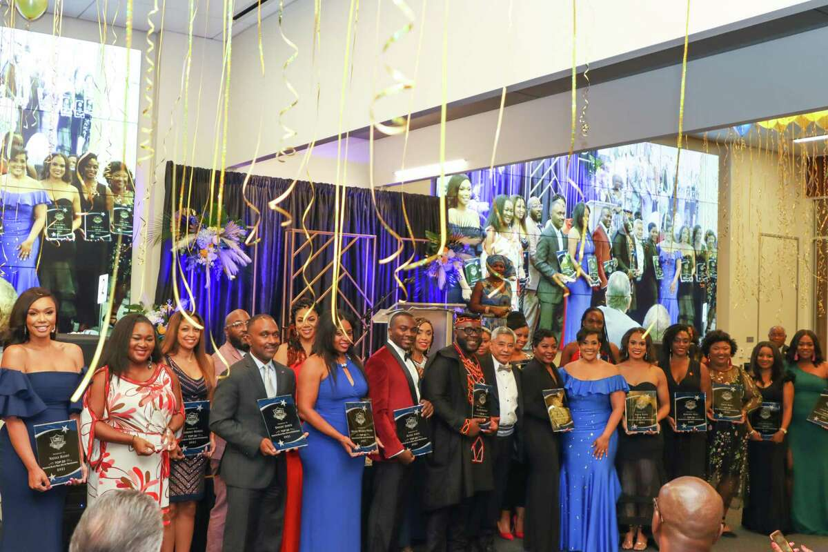 Award winners at the Houston Black Real Estate Association's bi-annual gala pose for a picture.