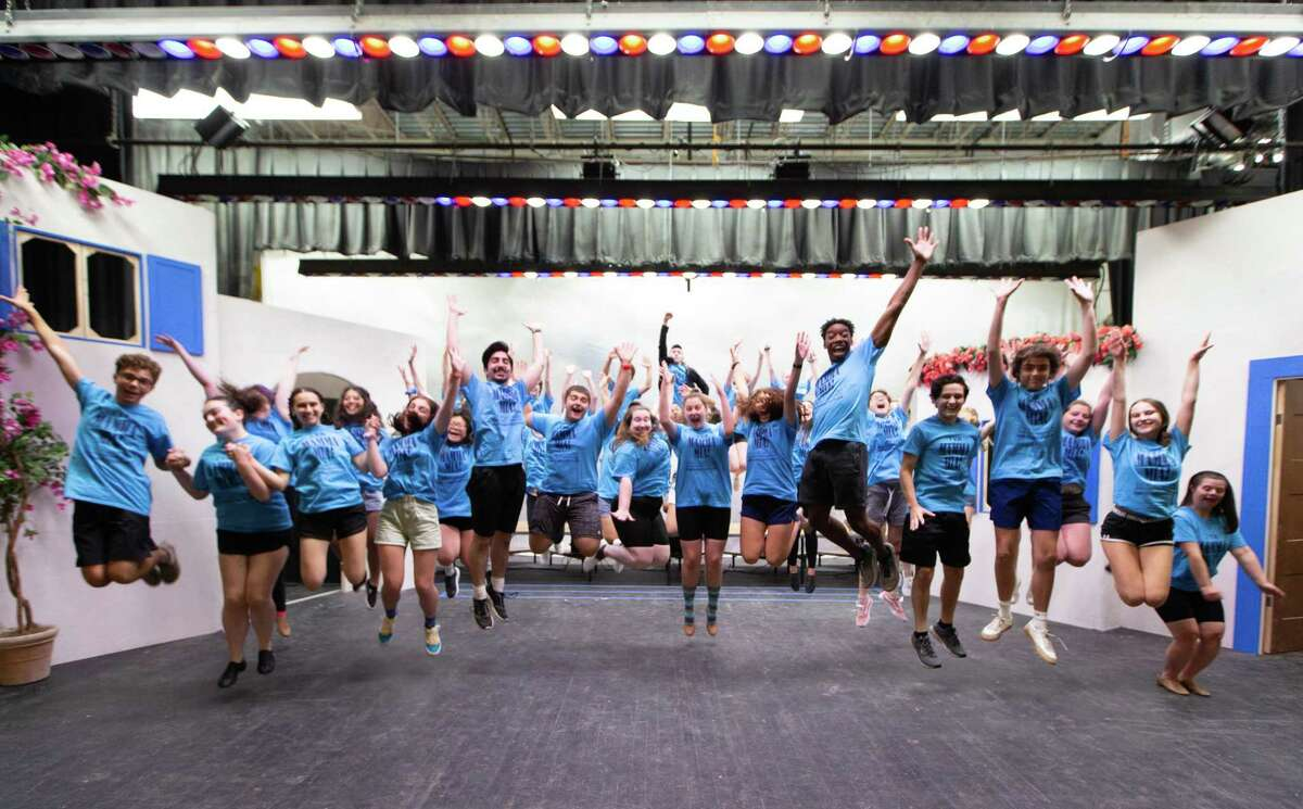 Members of the Trumbull Youth Association rehearse a scene from Mamma Mia!