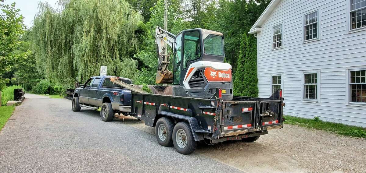 State police said the town's historic covered bridge along Route 128 will be closed for several hours Tuesday, July 20, 2021, after an excavator towed behind a truck struck the roof of the bridge. DOT officials determined the accident did not result in any structural damage, state police said.