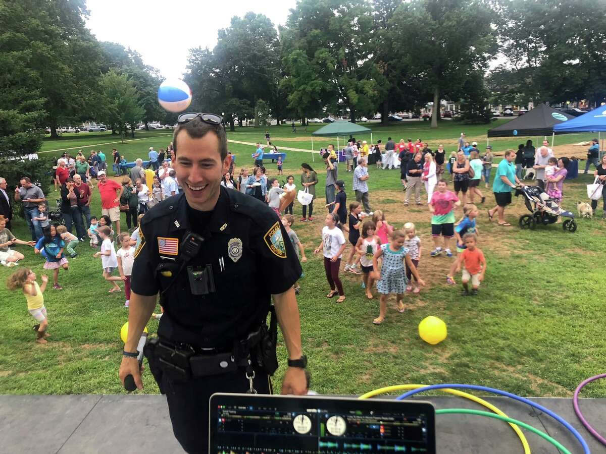 Guilford Police Officer Scott Gingras, serving as MC at the National Night Out event, gets the crowd excited at the 2020 event.