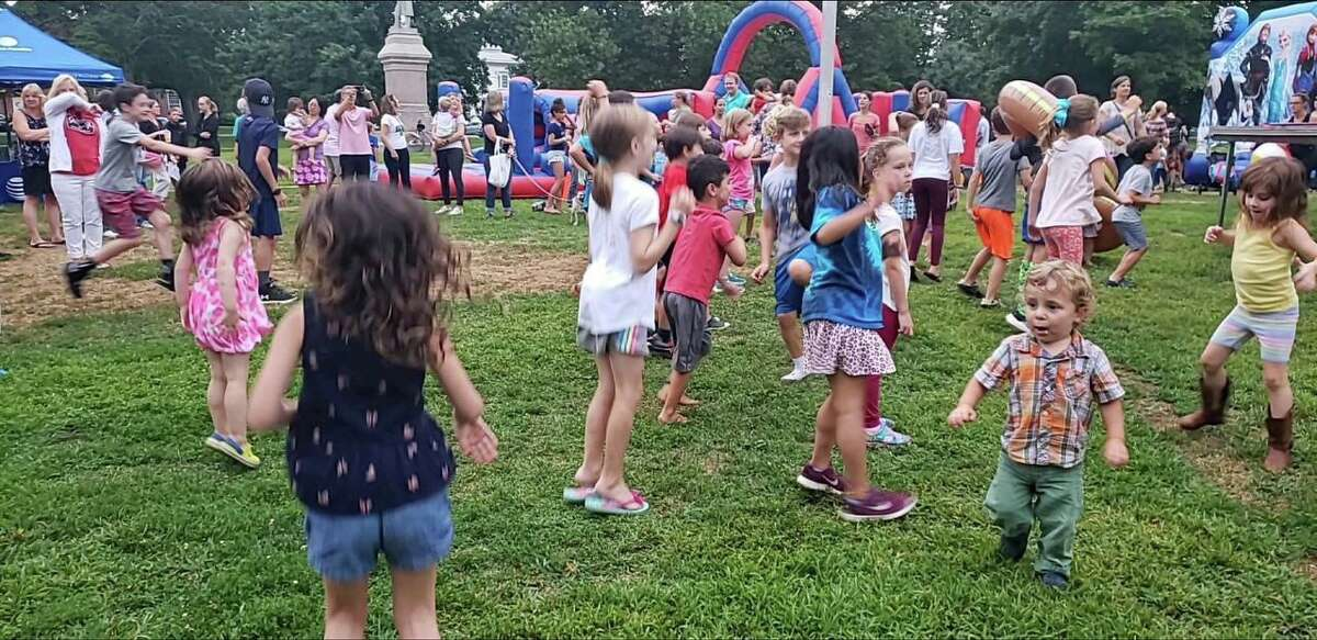 Youngsters enjoying a past National Night Out on the Guilford Green.