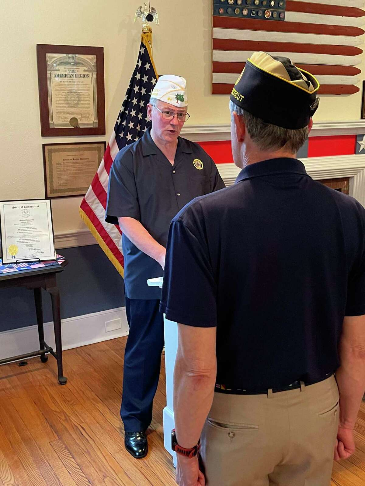 The American Legion Post 86 in Wilton, recently held its Installation of Officers ceremony at the Post, which is located at the town's 112 Old Ridgefield Road. Pictured is Department, (state,) Commander Jeff DeClerck charging Post 86 Commander Paul Niche with his duties.