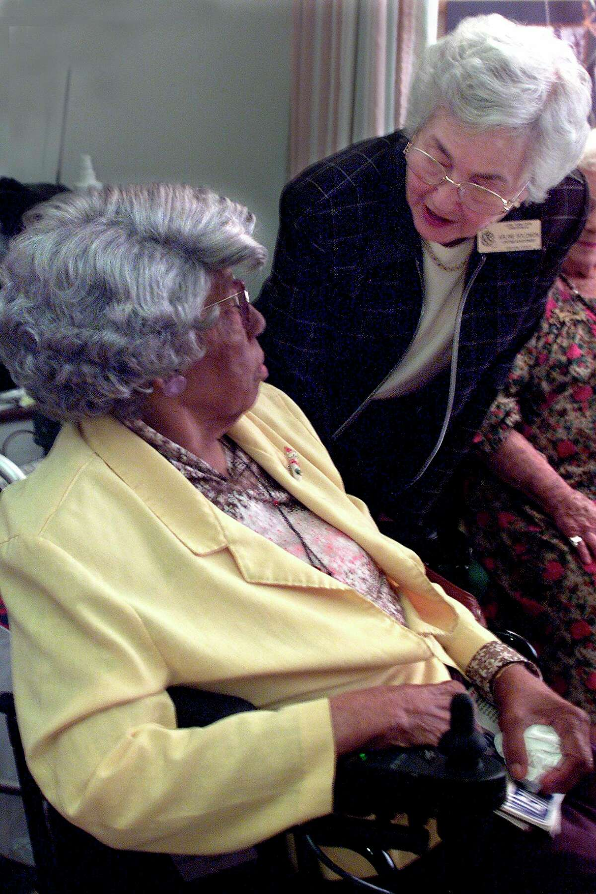 Arline Solomon, right, whovolunteers witha Long Term Care Ombudsman Program, speaks with a resident of a long-term care facility in Oxnard,California.The Long Term Care Ombudsman Program got its start in 1972. Today,there is an ombudsman program operating in every state across the U.S. (Photo by Anne Cusack/Los Angeles Times via Getty Images)