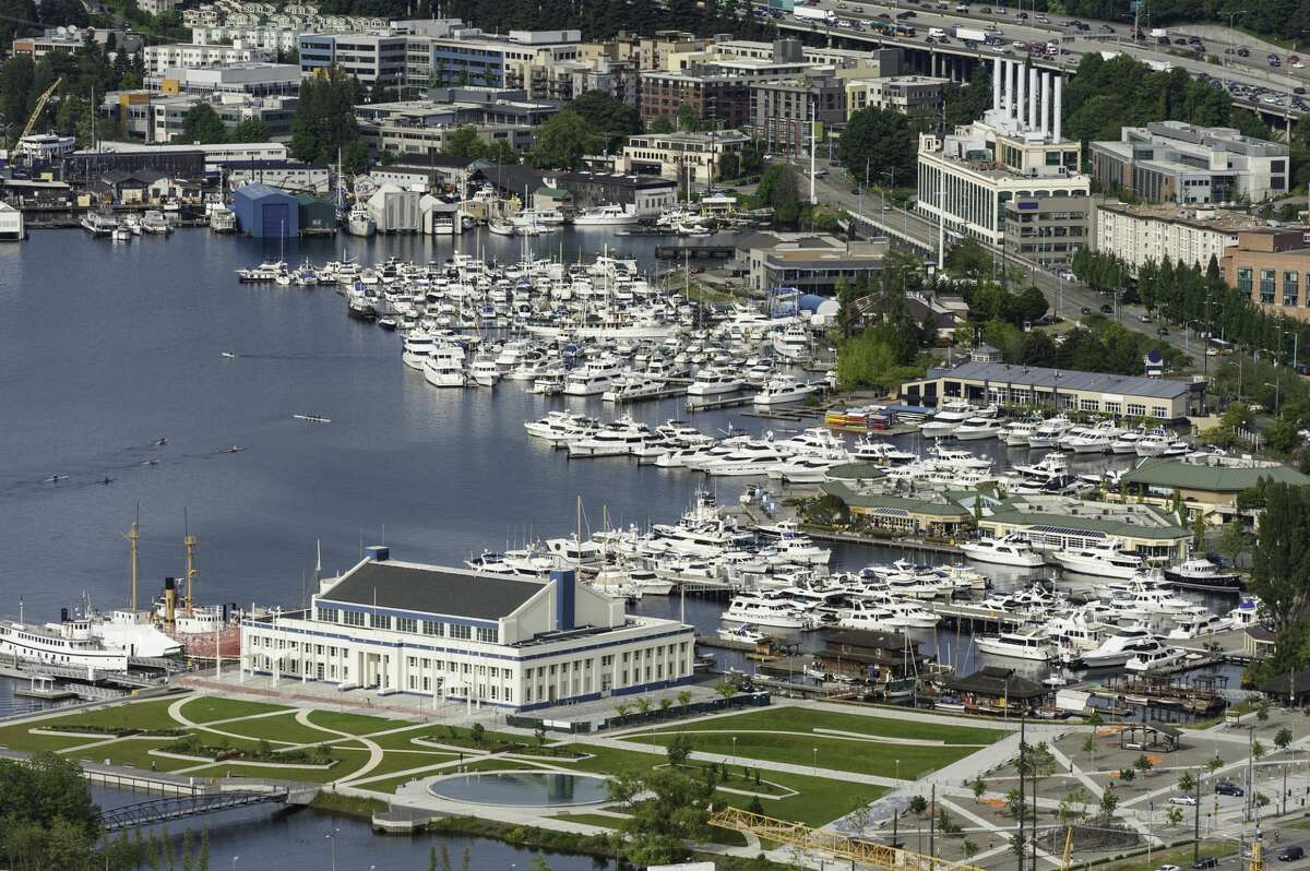 Aerial vista over the waterfront of Lake Union with its marinas, office buildings and apartment blocks.