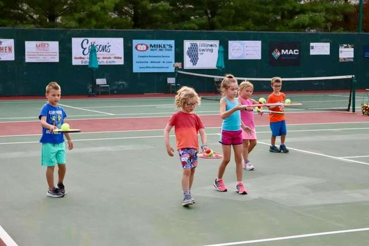 The Edwardsville Futures tennis tournament hosted Kids Night on Monday at the Edwardsville High School Tennis Center. The event was sponsored by the village of Glen Carbon. Approximately 40 youngster took part in the annual event at the professional tennis tournament. Children were able to learn the game of tennis through various drills conducted by the pros.