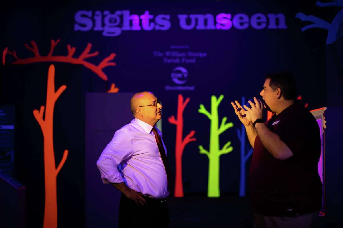 Garcia Hamilton & Associates, L.P. partner Gilbert Garcia, left, and Children's Museum of Houston director of educational technology and exhibit development Keith Ostfeld talk about the exhibition Sights Unseen at the Children's Museum of Houston, Friday, May 21, 2021, in Houston.