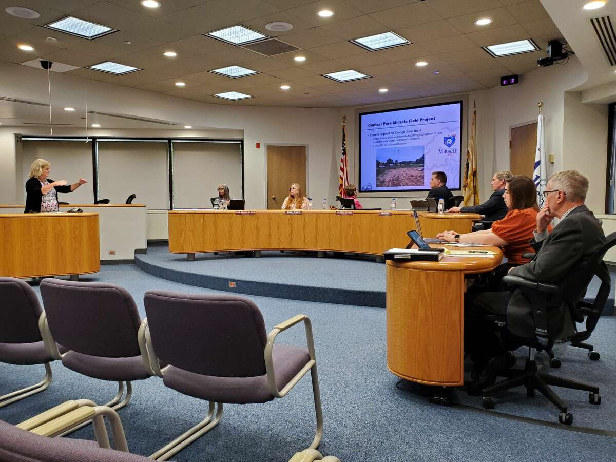 Director of the Department of Public Services Karen Murphy (left) talks to the Midland City Council about the Miracle Field on July 19, 2021.