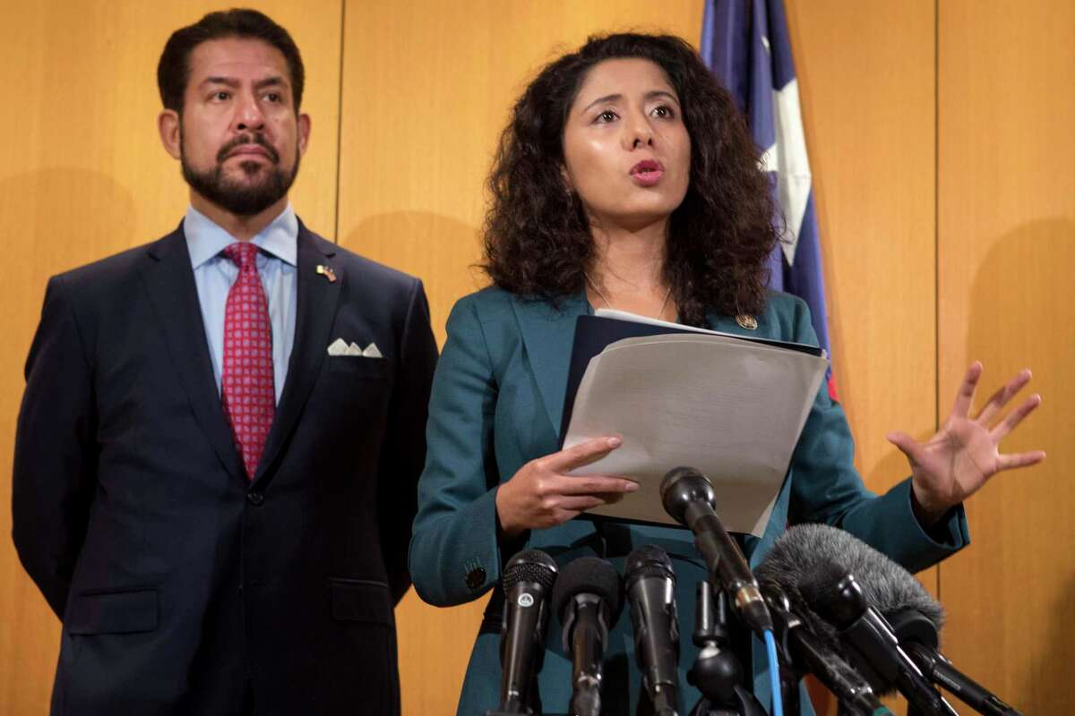 Harris County Judge Lina Hidalgo, standing with county commissioner Adrian Garcia, speaks about a $2.5 million proposal to add three visiting judges to eliminate the backlog in Harris County courts during a news conference Tuesday, July 20, 2021 in Houston.