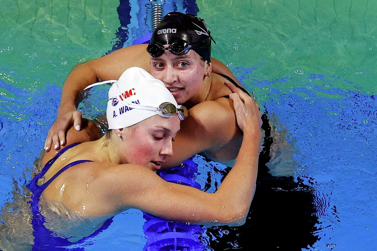 OMAHA, NEBRASKA - JUNE 15: Alex Walsh and Kate Douglass of the United States react after competing in a semifinal heat for the Women's 200m Individual Medley during Day Three of the 2021 U.S. Olympic Team Swimming Trials at CHI Health Center on June 15, 2021 in Omaha, Nebraska. (Photo by Maddie Meyer/Getty Images)
