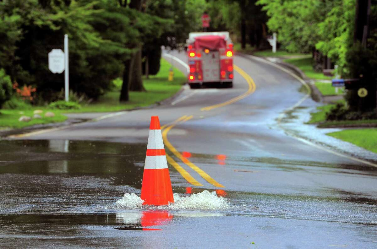 Water bubbles out onto Shore Road in Greenwich after a storm.
