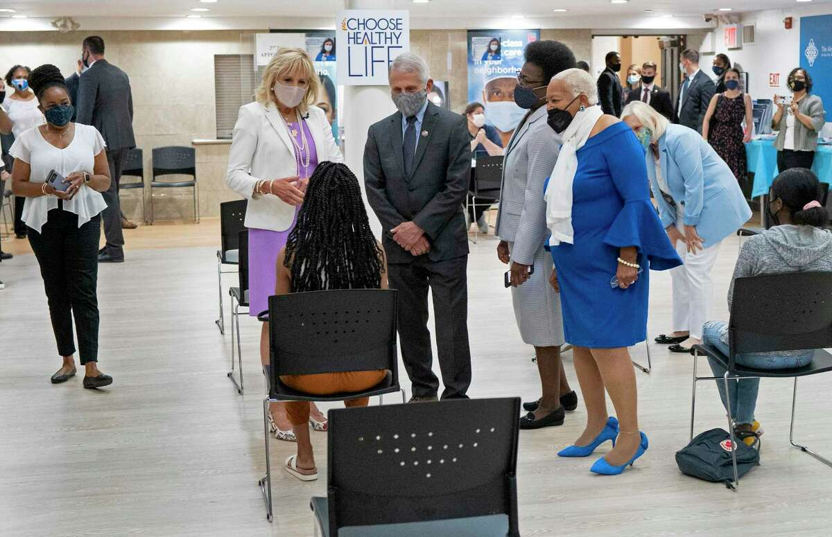 Debra Fraser-Howze, far right, founder of Choose Healthy Life, a collaboration with Black clergy to expand COVID vaccinations, tours a clinic with first lady Jill Biden and Dr. Anthony Fauci . As the government releases pandemic relief funds, it should value the power of the Black church.