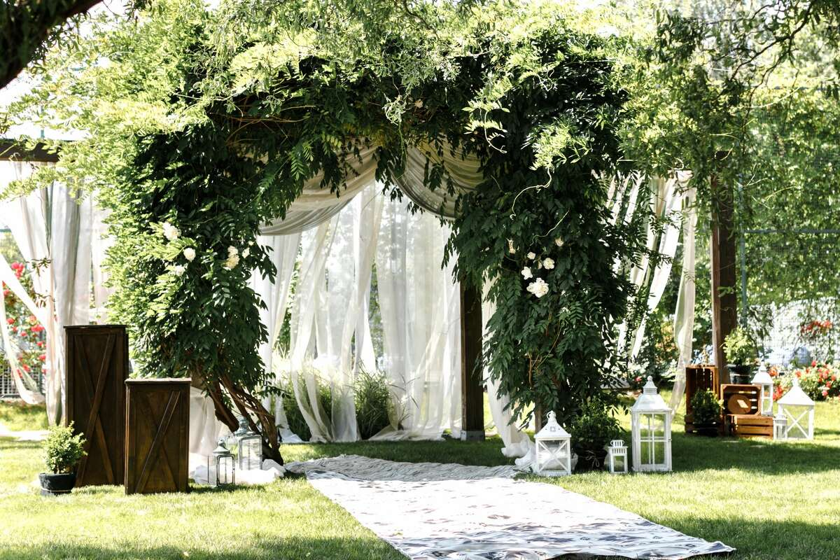 FILE - The scene for a wedding ceremony in the open air with a lot of greenery and trees.