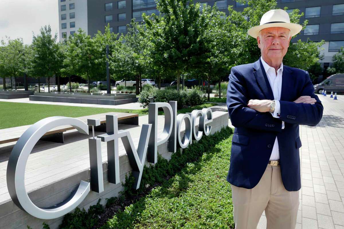 Alex Sutton, with DMB Developments and general manager of CityPlace Residential Ventures at the CityPlace sign by the park in the center Thursday, Jul. 15, 2021 in Spring, TX.
