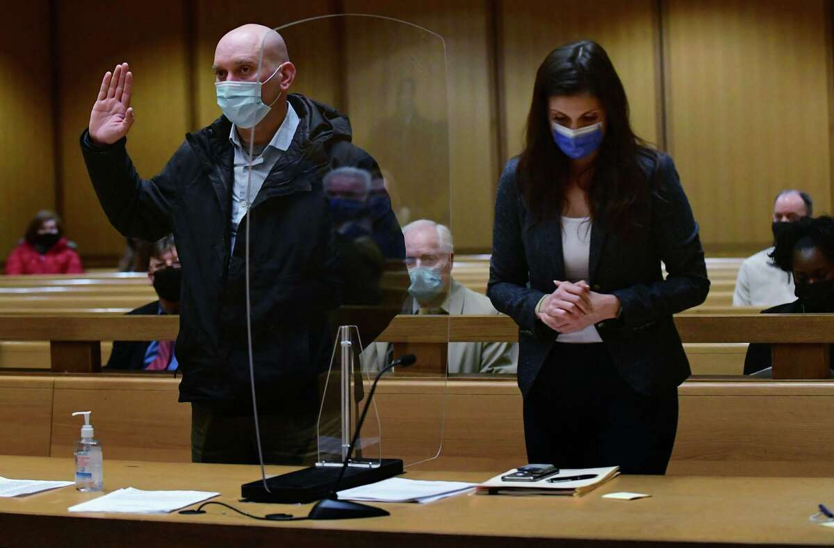 Norwalk police officer Michael DiMeglio, who was arrested in January for drinking on the job with another officer, appears with his attorney Jessica Kordas to be arraigned Wednesday, February 17, 2021, at Stamford Superior Court in Stamford, Conn.